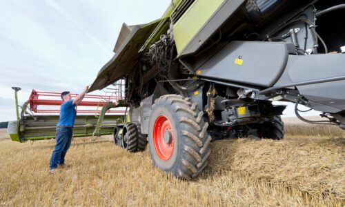 Combine Harvester Being Repaired In Field During Harvest, agriculture, farming, crops